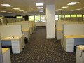 An empty set of cubicles at T-Mobile